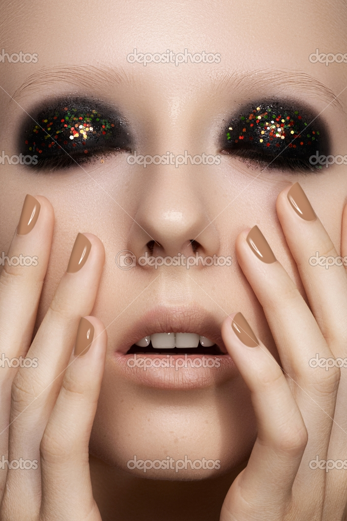 depositphotos_12252239-Beauty-close-up-portrait-of-sexy-model-woman-with-dark-smoky-eye-make-up-bright-glitter-on-eyelids-perfect-beige-nails-polish.-Cosmetics-makeup-and-manicure